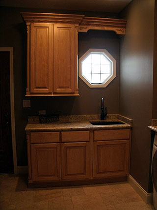 laundry room cabinets with a built in sink